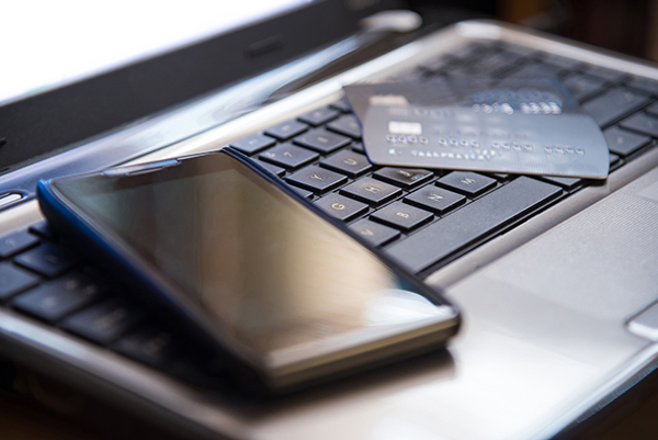 phone and credit card on top of laptop keyboard